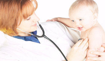Doctor holding stethoscope to baby s chest an.jpg